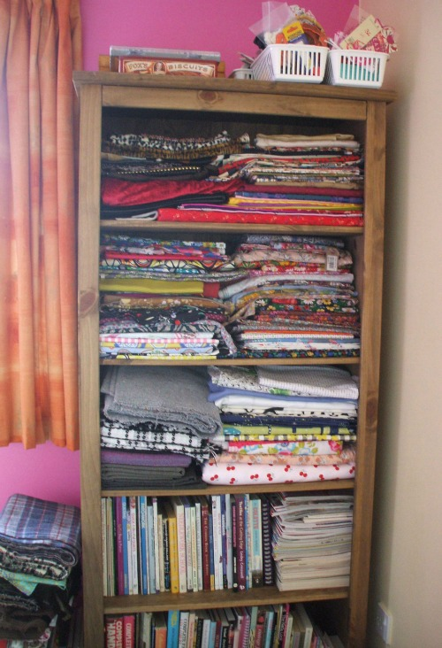 Lots of lovely fabric and craft things on shelves