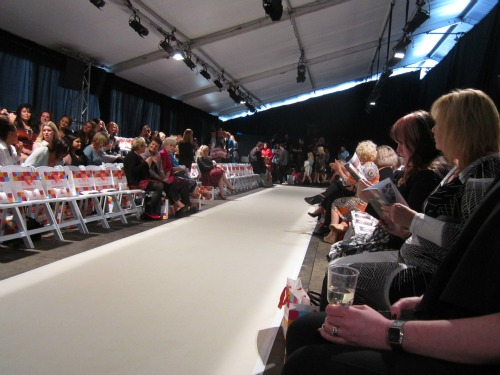 Waiting for the show to begin, watching the press people congregate at the end of the runway
