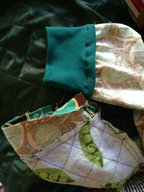 Sleeve and lining next to each other, attached by small pinned section